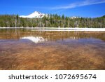 Small photo of North America, United States, Oregon, Eastern Oregon, Cascade Lakes Highway, Cascade Mountains, Middle Sister, Hope, Sisters Mountain. Mt Bachelor, Bachelor Butte. Stratovolcanos. Snow. Lake.