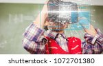 Small photo of Digital composite of Digital composite image of tech graphs with man using VR glasses in background