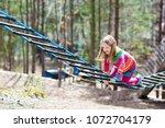 child in forest adventure park. ...   Shutterstock . vector #1072704179