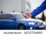 the keys to a new blue sports... | Shutterstock . vector #1072724090