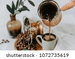 hot turkish coffee pot .... | Shutterstock . vector #1072735619