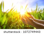 human hands open palm up worship | Shutterstock . vector #1072749443
