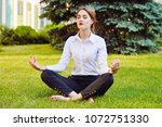 office yoga. business lady in... | Shutterstock . vector #1072751330
