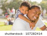 happy african american father... | Shutterstock . vector #107282414