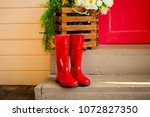 red rubber shoes on the steps... | Shutterstock . vector #1072827350