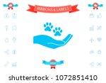 hand holding paw symbol. animal ...   Shutterstock .eps vector #1072851410