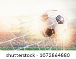 soccer ball hit the net against ... | Shutterstock . vector #1072864880