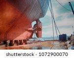 a cargo ship in dry dock | Shutterstock . vector #1072900070