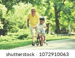 happy grandfather and child... | Shutterstock . vector #1072910063