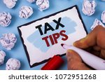 Small photo of Conceptual hand writing showing Tax Tips. Business photo text Help Ideas for taxation Increasing Earnings Reduction on expenses
