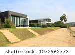 modern luxury house in front of ... | Shutterstock . vector #1072962773