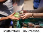 poverty concept feeding food... | Shutterstock . vector #1072965056