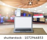 blank screen laptop on table... | Shutterstock . vector #1072966853