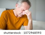 senior man suffering from... | Shutterstock . vector #1072968593