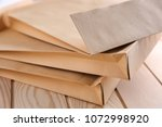 Small photo of Brown envelopes on wooden table, closeup. Mail service