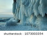 Small photo of Russia. Because of strong storms and high waves in the autumn time, the shores of Lake Baikal are covered with ice shroud in winter