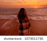 young woman wrapped in a plaid... | Shutterstock . vector #1073011730