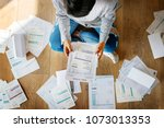 woman managing the debt | Shutterstock . vector #1073013353