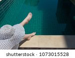 a girl in a white hat sits on... | Shutterstock . vector #1073015528