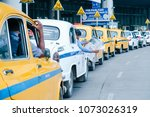 taxi driver take a break and... | Shutterstock . vector #1073026319