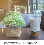 iced coffee glass and bouquet... | Shutterstock . vector #1073027213