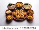 pani puri is indian chat served ... | Shutterstock . vector #1073030714