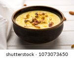 kheer or rice pudding is an... | Shutterstock . vector #1073073650