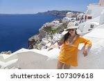beautiful girl in santorini... | Shutterstock . vector #107309618