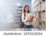 young female student studying... | Shutterstock . vector #1073110316