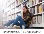 young female student studying... | Shutterstock . vector #1073110340