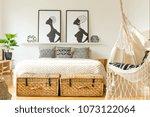 swing in a rustic bedroom... | Shutterstock . vector #1073122064