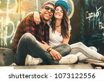 young teen couple sitting by... | Shutterstock . vector #1073122556