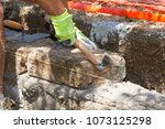 bricklayer making a new wall | Shutterstock . vector #1073125298