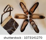 Small photo of Rustic Purse with Matching Brown Tone Shoe Options; Top View, Shoe Placement Resembles a Star, Star Fish or Butterfly Pattern; Let's Go Shopping, Let's Be Trendy Ideas