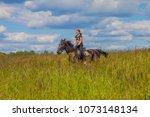 beautiful redheaded girl riding ... | Shutterstock . vector #1073148134