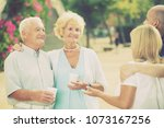 positive mature parents with... | Shutterstock . vector #1073167256