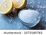 lemon sea salt crystals on blue ... | Shutterstock . vector #1073180783