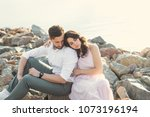 a beautiful young couple is... | Shutterstock . vector #1073196194
