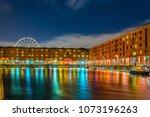 night view of illuminated... | Shutterstock . vector #1073196263