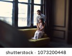 young couple hugging by the... | Shutterstock . vector #1073200448