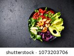 colorful poke bowl with roasted ... | Shutterstock . vector #1073203706