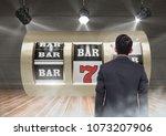 back of man looking at casino...   Shutterstock . vector #1073207906