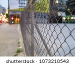 iron net in safety zone... | Shutterstock . vector #1073210543