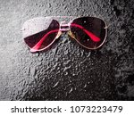stylish pink sunglasses with... | Shutterstock . vector #1073223479