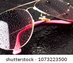 stylish pink sunglasses with... | Shutterstock . vector #1073223500
