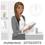 black business woman holding... | Shutterstock .eps vector #1073225573