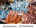 dried and smoked fish at the... | Shutterstock . vector #1073249636