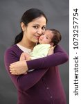 young mother kissing her... | Shutterstock . vector #1073257754