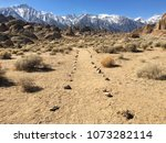 pathway leading to the mountains   Shutterstock . vector #1073282114