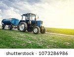 Tractor Of Blue Color With A...